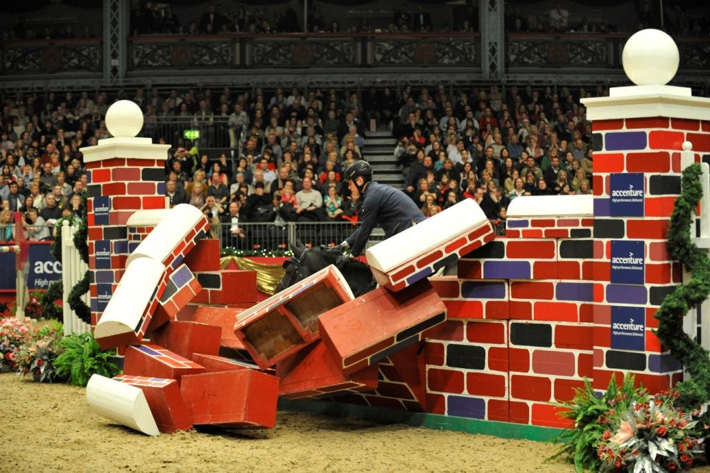 the famous puissance at olympia the london international horse show. Black Bedroom Furniture Sets. Home Design Ideas